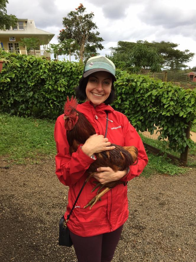 NKLA cat volunteer Mollie holding a rooster