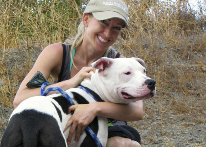 Volunteer Victoria Vertuga with a pit bull terrier