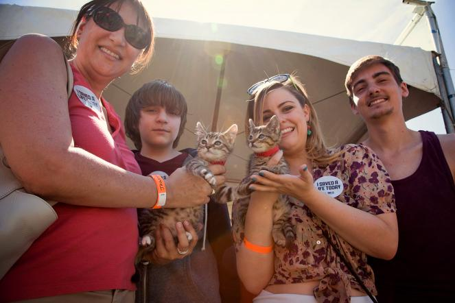 Family holding kittens they adopted