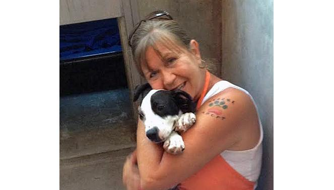 Volunteer Patty Parks with a dog