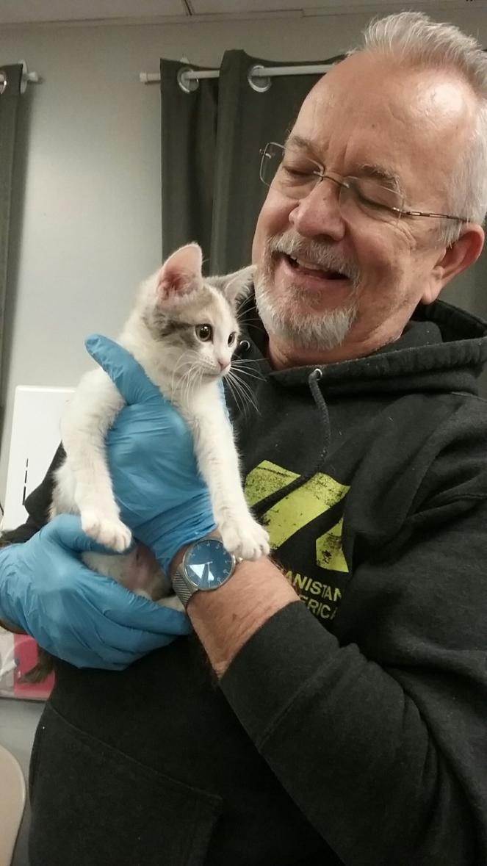 Volunteer Scott with Elf the kitten