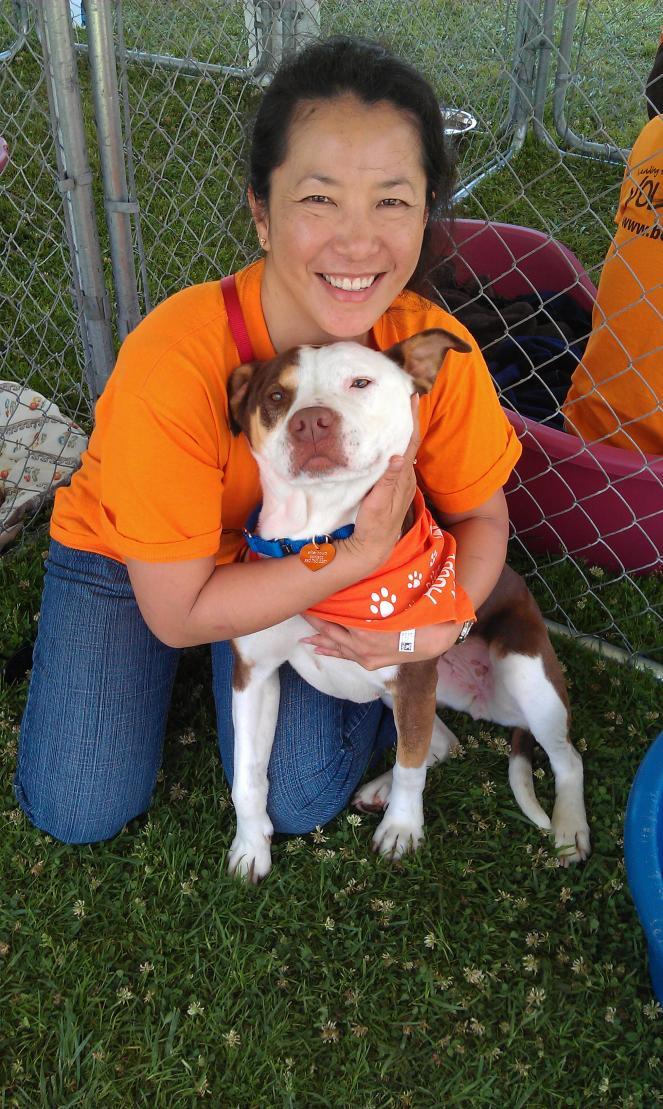 Volunteer Sophia Lim with a dog