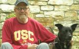 Volunteer Bill with his black dog