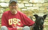 Volunteer Bill with his black dog