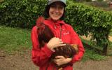 NKLA cat volunteer Mollie holding a rooster