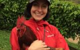 Volunteer Mollie with a rooster